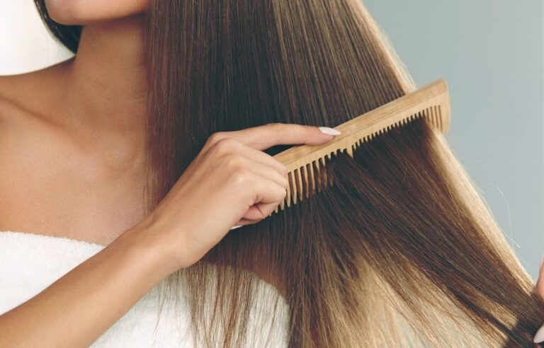 Girl combing Her Hair With The Best Wooden Combs For Hair Growth